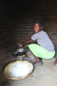 Fainess, one of our sponsored students, cooking in her family's kitchen