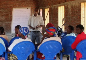 Yohane leading a training session for guardians of families overloaded with orphans