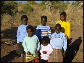 Six of the twelve orphans in the first family to be registered with Kindle.  Their grandmother had died, leaving them an orphan-headed household. They are shown wearing one of Kindle's first donations – sweaters made and sent by a lady in Australia.