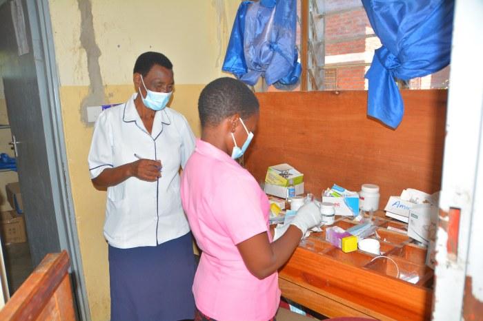 Mrs Lydia Mwimba (nurse and Thoko Gulule Assistant at Katawa)